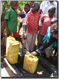 Running water - Ugandians filling water jugs.